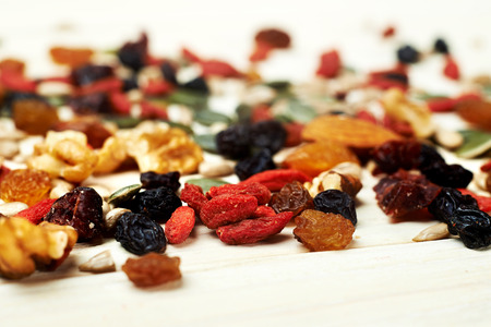 dry fruits: mix nuts seeds and dry fruits, on a wooden table Stock Photo