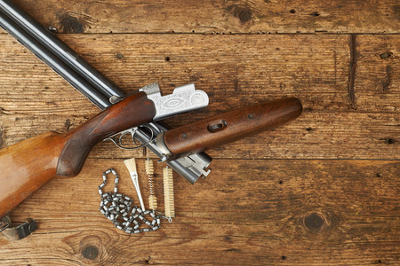 antique rifle: hunting gun with cleaning kit on a wooden table