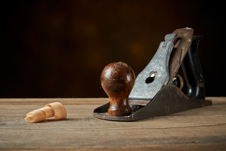 Woodworking tool. Hand plane on a wooden workbench.