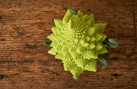 kitchen bench: Romanesco cauliflower broccoli on a wooden kitchen bench. Stock Photo
