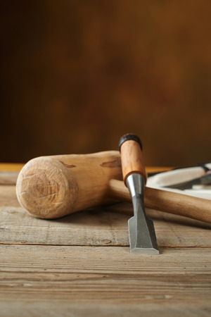 woodworking tolls, chisels and mallet on a workbench