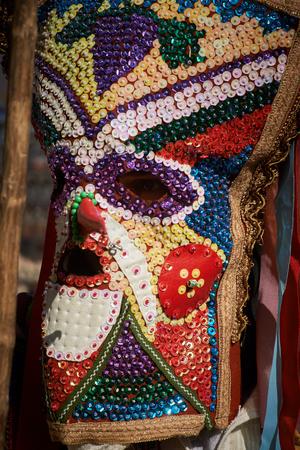SHIROKA LAKA, BULGARIA - MARCH 5: People dressed in traditional costumes called Kukeri celebrate arrival of Spring with ritual dances in Shiroka Laka, Bulgaria, on March 5, 2017.