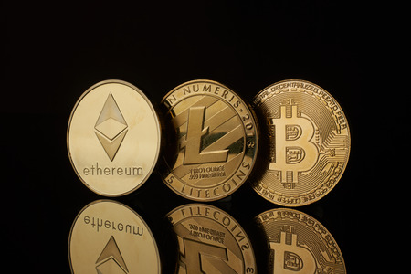 conceptual image for crypto currency. Ethereum Litecoin Bitcoin gold coins.