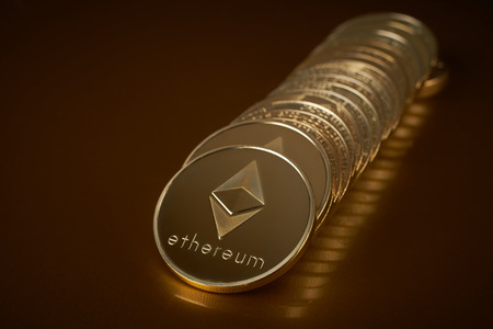 conceptual image for crypto currency. Ethereum gold coin.