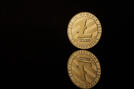conceptual image for crypto currency. Litecion gold coin. Imagens