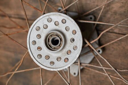 part of an old rusty motorcycle wheel closeup