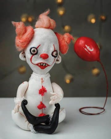 handmade toy from movie It, Pennywise the dancing clown, and red ball