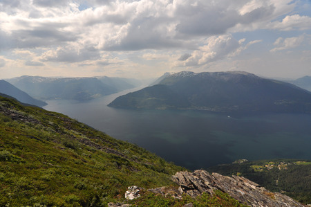 plunging: Norwegian nature There are mountains plunging into the sea from hundreds of metres, fjords, tall mountain peaks, northern lights and midnight sun.