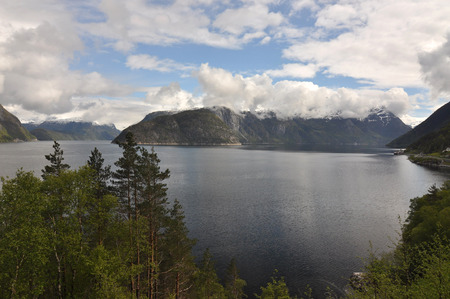 plunging: Norwegian nature. There are mountains plunging into the sea from hundreds of metres, fjords, tall mountain peaks, northern lights and midnight sun. Stock Photo