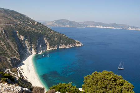 Myrtos Beach, Kefalonia, Greece. Myrtos Beach is in the region of Pylaros, in the north-west of Kefalonia island, in the Ionian Sea of ??Greece. Stock Photo