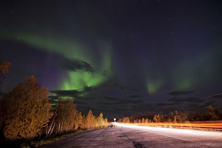 light display: Northern lights or polar lights. An aurora is a natural light display in the sky, predominantly seen in the high latitude Arctic and Antarctic regions.