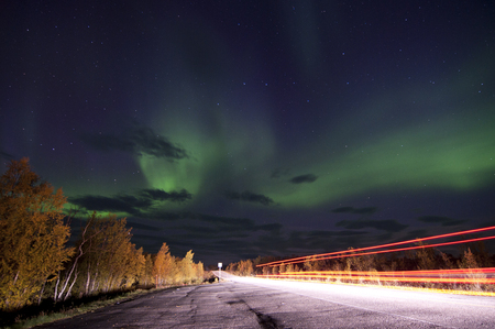 Northern lights or polar lights. An aurora is a natural light display in the sky, predominantly seen in the high latitude Arctic and Antarctic regions.