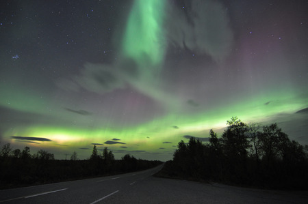 ionosphere: Northern lights or polar lights. An aurora is a natural light display in the sky, predominantly seen in the high latitude Arctic and Antarctic regions.