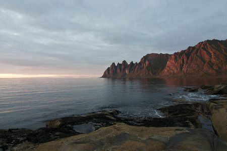 Norway, island Senja, sunset near Okshornan