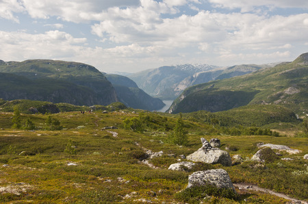 Norway. Norwegian nature. There are mountains plunging into the sea from hundreds of meters, fjords, tall mountain peaks, northern lights and midnight sun.