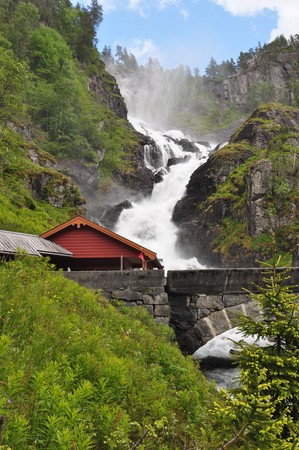 Latefossen. Latefossen or Latefoss is a waterfall located in the municipality of Odda in Hordaland County, Norway. The 165-metre tall waterfall is unique and thus it is a well-known tourist attraction in the area. Stock Photo
