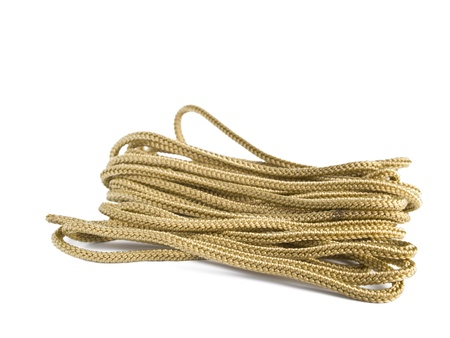 convolute: Pair of long convolute tan shoe-laces isolated on white background
