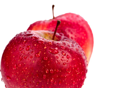Two wet red apples with water drops isolated on white background photo