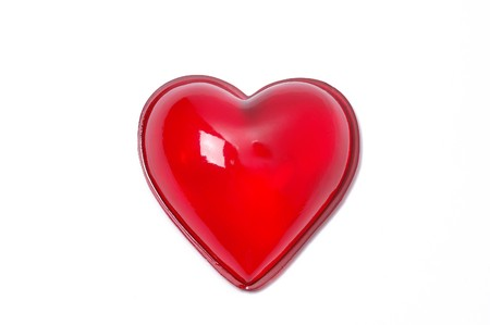 Red glass heart isolated on white background