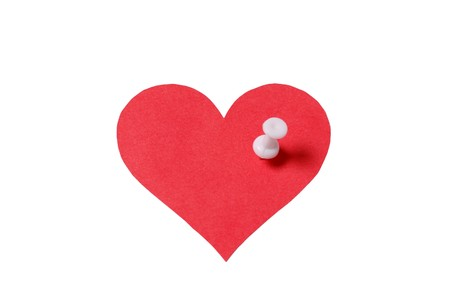 Red heart with white pin isolated on white background