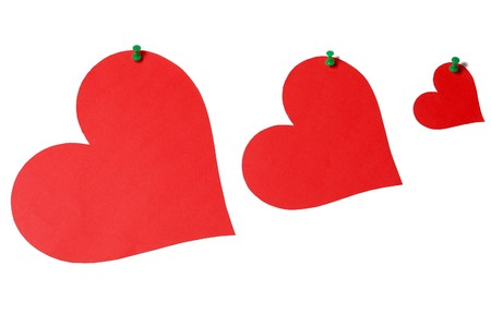 Red hearts with green pins isolated on white background