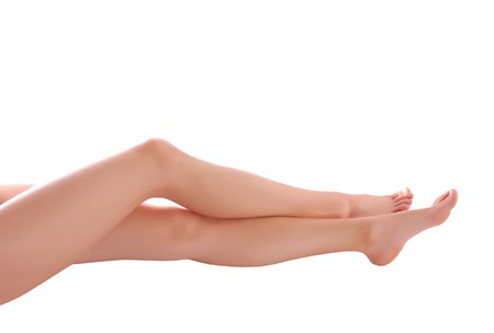 Smooth woman legs isolated on white background