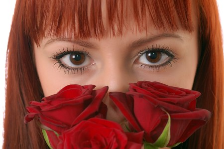 Portrait of beautiful girl with red roses on white background