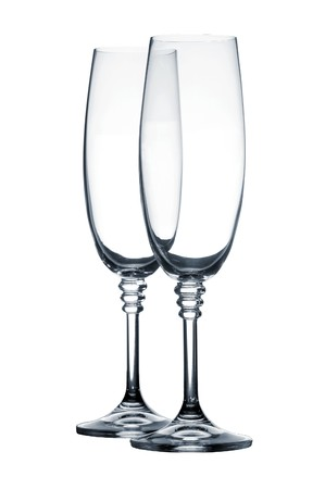 Empty champagne glasses on white background
