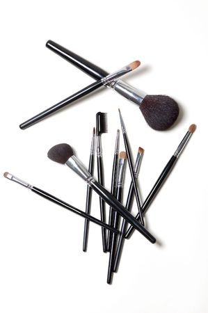 Different makeup brushes isolated on white Stock Photo