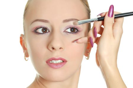 Young attractive woman with make-up brush Stock Photo