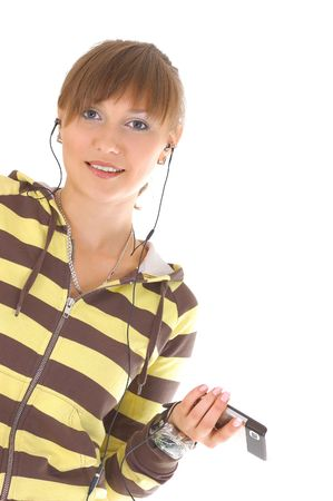 Teenager girl listening music with cell phone