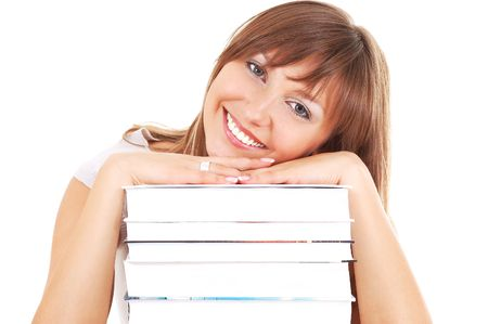 Young smiling woman with books pile isolated on white