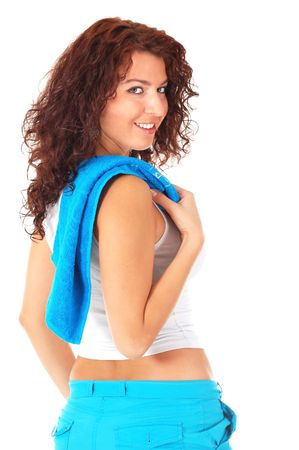 Beautiful girl with towel after physical exercises isolated on white background photo