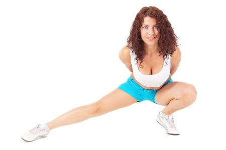 Beautiful athletic girl doing stretching isolated on white background  photo