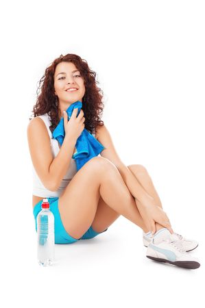 Attractive woman resting after exercise photo