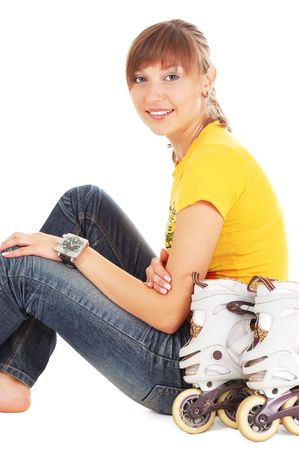 Beautiful smiling teenager with rollerblades on white background