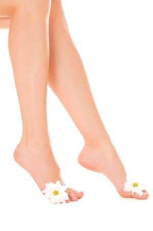 Beautiful woman legs with flower isolated on white background