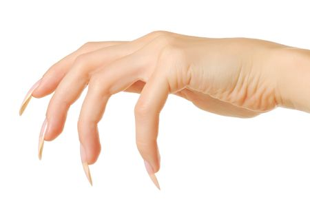 Predatory woman hand with nails isolated on white background