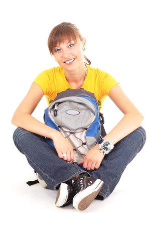 Beautiful happy teenager girl with rucksack isolated on white background