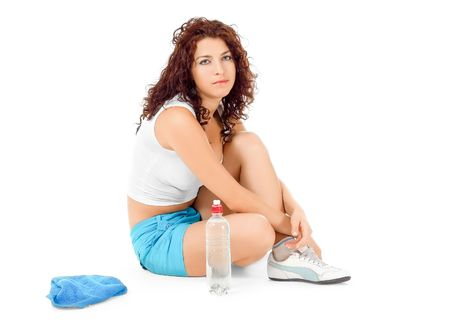 Woman resting after sports isolated on white photo