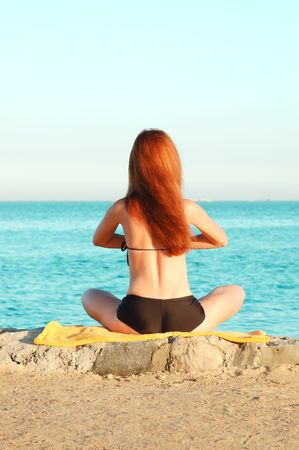 Young woman relaxing near the sea Stock Photo