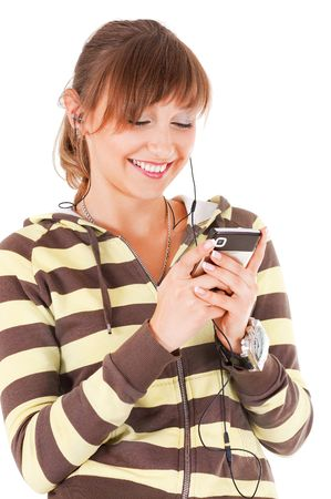 Smiling teenager with the cell phone on white background