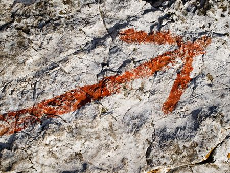 painted red arrow on the stone
