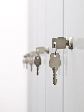 Keys in the row hanging from the locker doors,shallow DOF photo