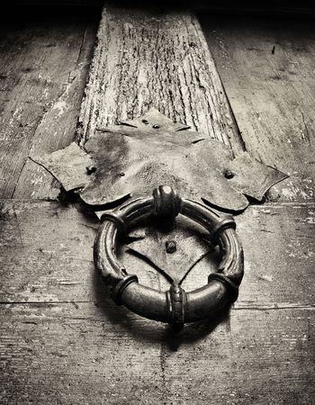 door knocker on an ancient doors, closeup , black and white photo