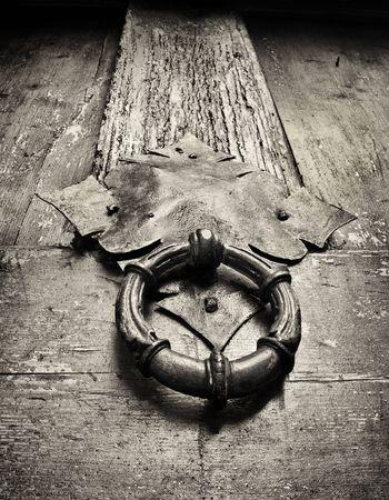 door knocker on an ancient doors, closeup , black and white