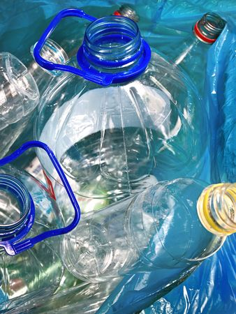 plastic empty bottles in the bag for recycling