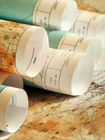 closeup of rolls of maps laing on the opened map Stock Photo