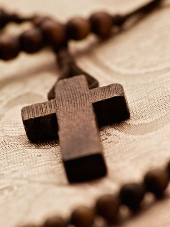 closeup of rosary cross,shallow DOF, light sepia toned