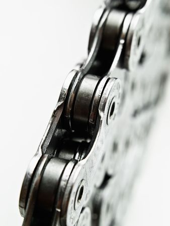 linking together: stacked bicycle chain macro,over white background, may suggest strength,unity...